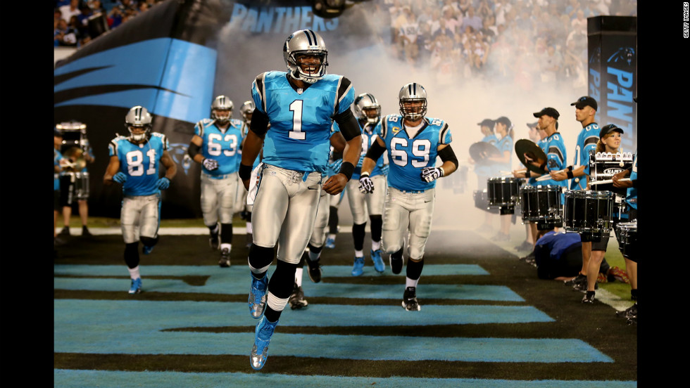 "Quarterback Cam Newton of the Carolina Panthers leads his teammates onto the field to play against the New York Giants on Thursday. <a href=""http://www.cnn.com/2012/09/13/football/gallery/nfl-week-2/index.html"" target=""_blank""><strong>Look back at the best of Week 2</a></strong> and at <a href=""http://www.cnn.com/SPECIALS/world/photography/index.html"" target=""_blank""><strong>see more of CNN's best photography</a></strong>."