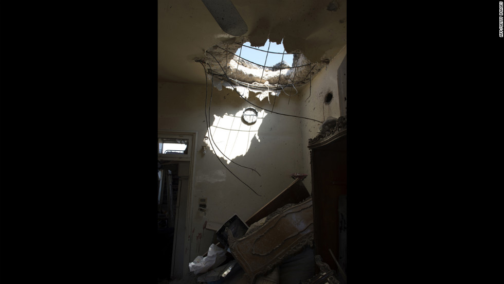 Friday's attack by Syrian forces leaves a hole in a house in Aleppo where a child was killed.