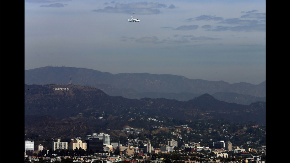 Endeavour flies near the Hollywood sign on Friday.