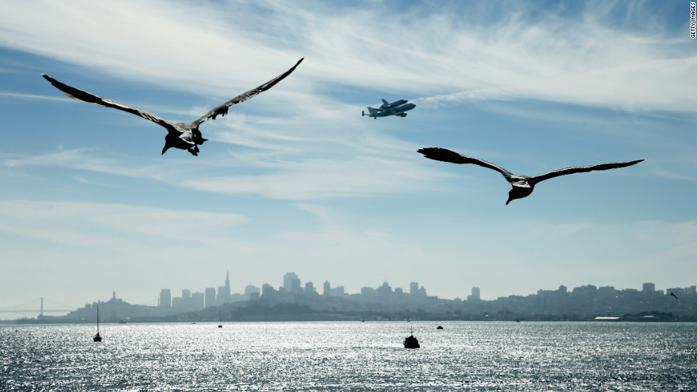The space shuttle passes over San Francisco before making its final landing in Los Angeles.