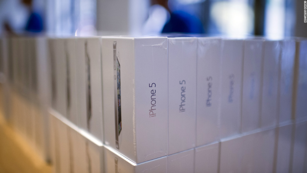 Piles of Apple's new iPhone 5 sit in boxes in an Apple store in Paris.