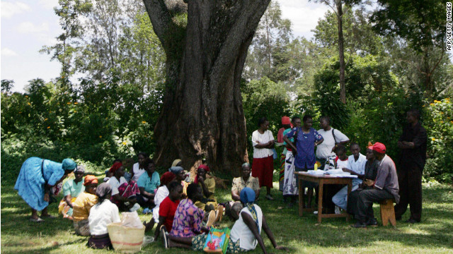 Women wanting to get loans wait to speak with a representative from a microcredit entity in Sauri, eastern Kenya,