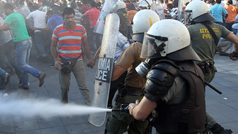Riot police clash with demonstrators in Athens, Greece, on Sunday, September 23.