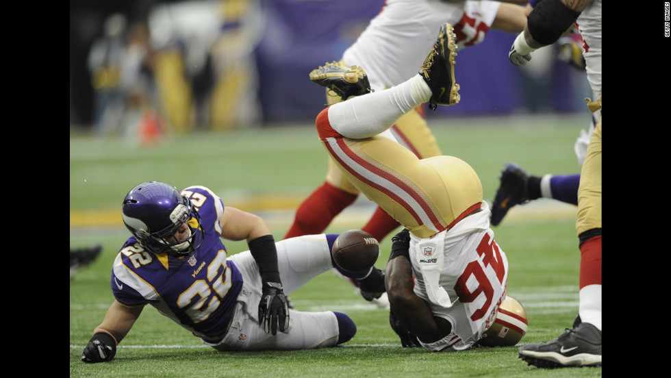 Harrison Smith of the Minnesota Vikings tackles Delanie Walker of the San Francisco 49ers during the first quarter Sunday.