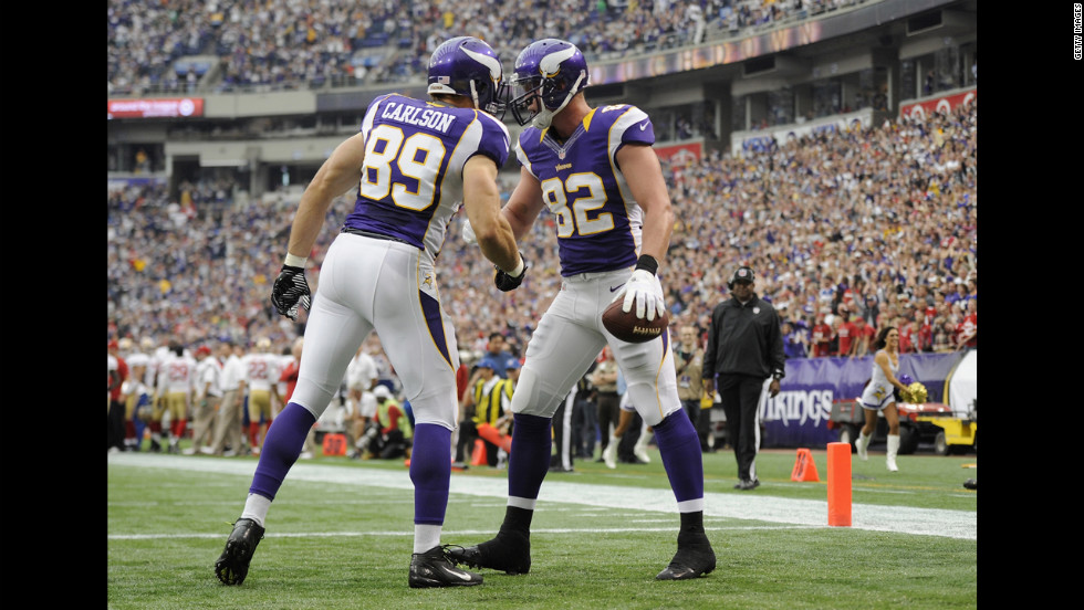 Minnesota's Kyle Rudolph, right, celebrates with John Carlson after scoring a touchdown against San Francisco.