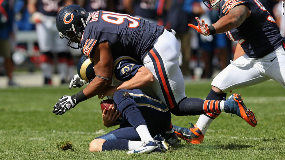 Amobi Okoye of the Chicago Bears sacks Sam Bradford of the St. Louis Rams at Soldier Field in Chicago.