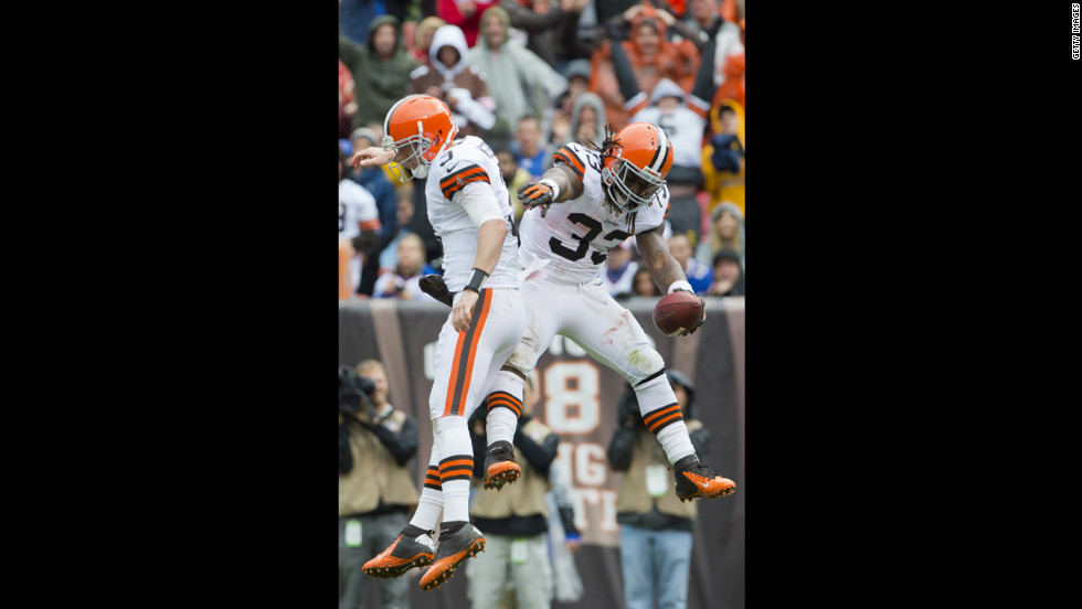 Browns quarterback Brandon Weeden, left, celebrates with Richardson after the rookie running back's touchdown against the Bills.