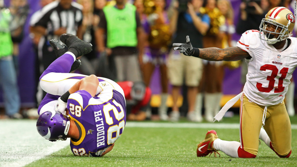 Kyle Rudolph of the Minnesota Vikings rolls in the endzone for a touchdown Sunday while Donte Whitner of the San Francisco 49ers looks to the referee.