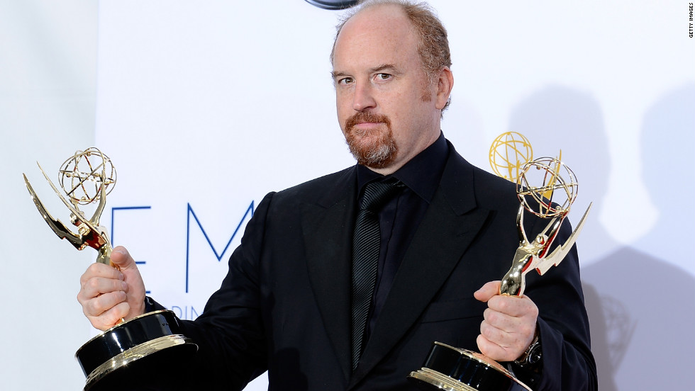 "Louis C.K. holds his two trophies for oustanding comedy writing for ""Louie"" and outstanding writing on a variety, music or comedy special for ""Live at the Beacon Theatre."""