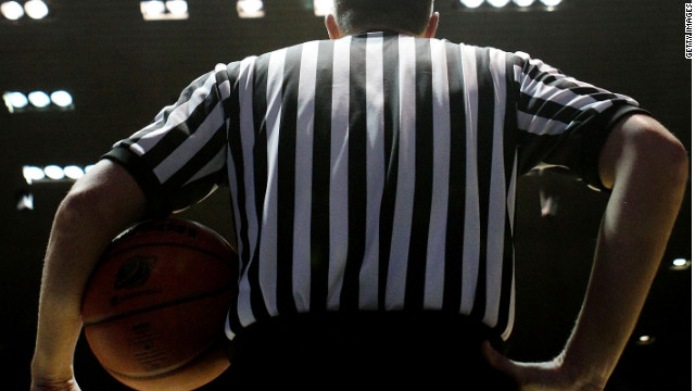 A referee waits during a game between Harvard and Vanderbilt during the 2012 NCAA Men's Basketball Tournament.