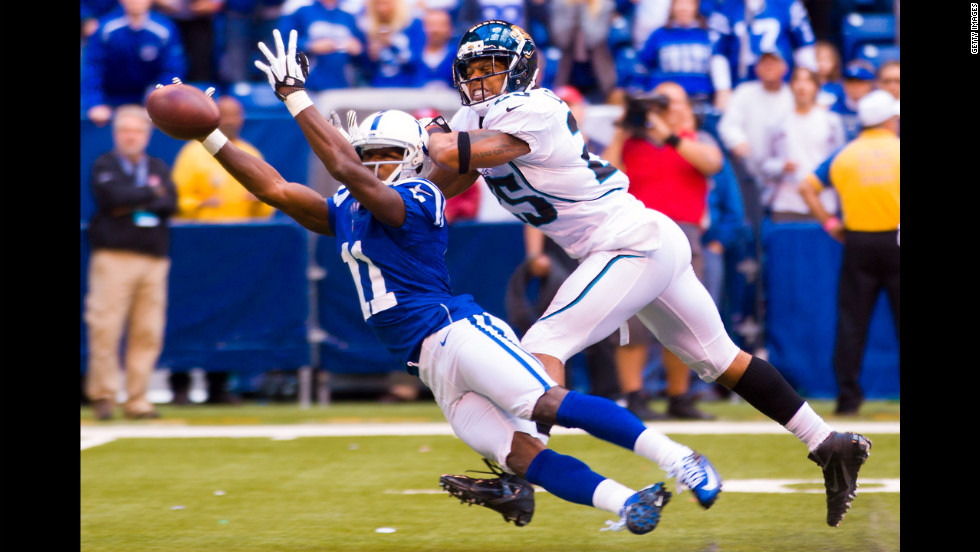 Donnie Avery of the Indianapolis Colts reaches out for a catch that fell incomplete as Dwight Lowery of the Jacksonville Jaguars defends Sunday in Indianapolis.