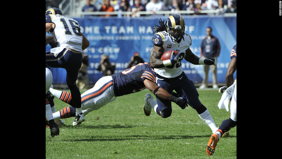 Lance Briggs of the Chicago Bears tackles Steven Jackson of the St. Louis Rams on Sunday at Soldier Field in Chicago.