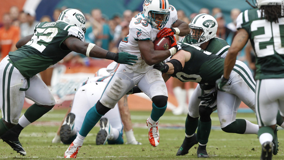Daniel Thomas of the Miami Dolphins runs with the ball during Sunday's game against the New York Jets at Sun Life Stadium in Miami Gardens, Florida. The Jets defeated the Dolphins 23-20 in overtime.