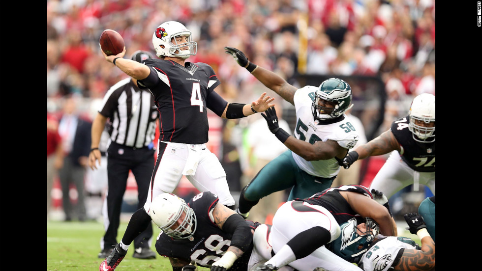 Kevin Kolb of the Cardinals throws a 37-yard touchdown during the second quarter against the Eagles.