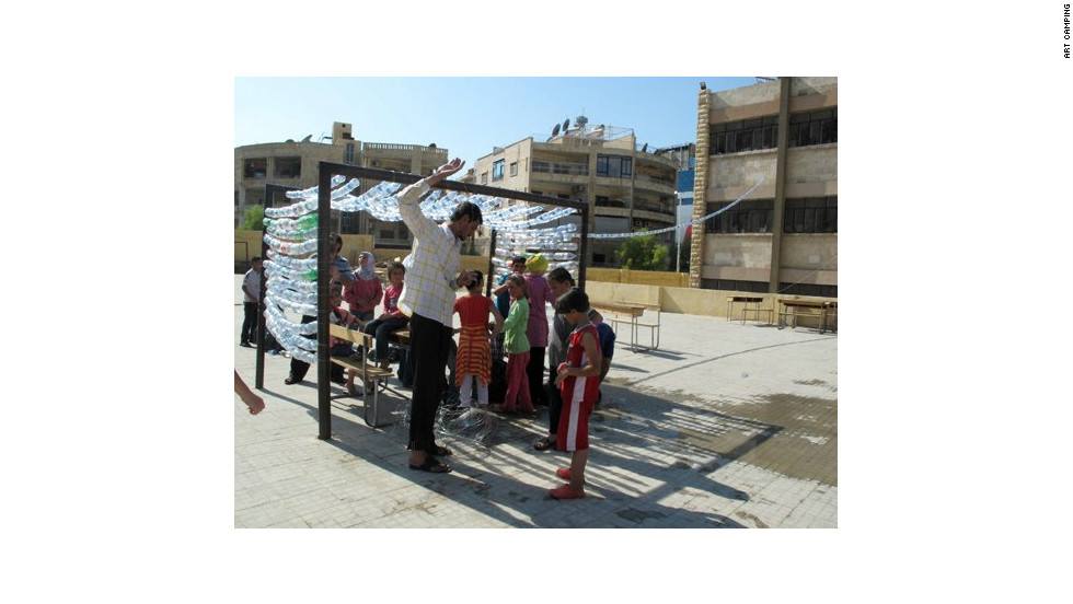 Refugee children in Aleppo taking part in an Art Camping workshop on August 16, three days before fighting reached the city center.