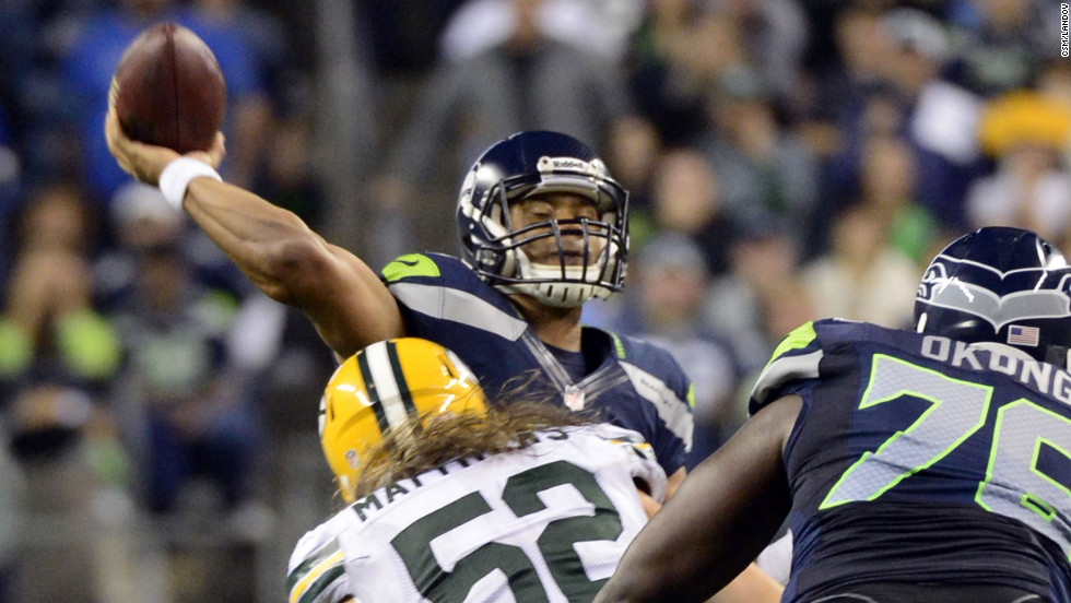 Seattle Seahawks quarterback Russell Wilson throws the winning touchdown pass against the Green Bay Packers in Seattle on Monday night. The Seahawks defeated the Packers 14-12 after a much-questioned call by the referees.