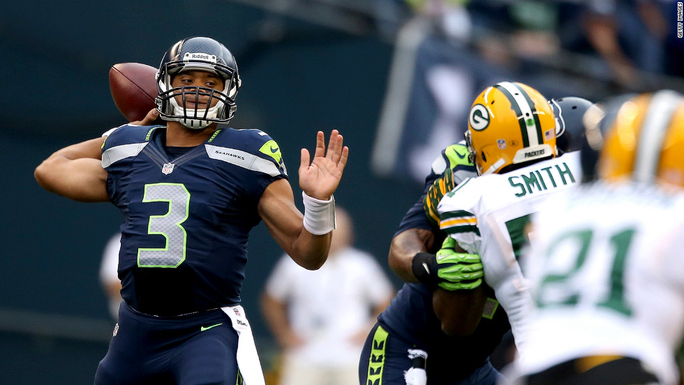Quarterback Russell Wilson of the Seattle Seahawks throws a pass in the first half against the Green Bay Packers on Monday.
