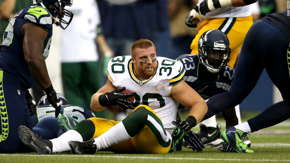 John Kuhn of Green Bay looks around after losing his helmet on a play.
