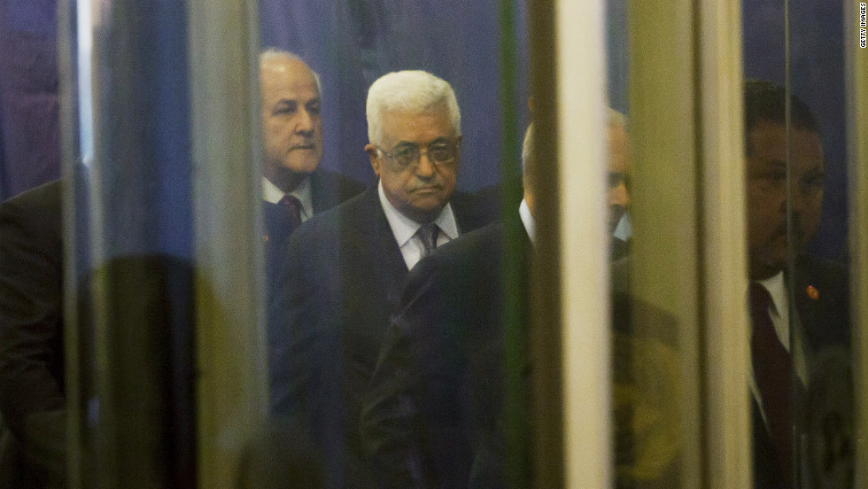 Palestinian Authority President Mahmoud Abbas, center, arrives at the United Nations on Tuesday.