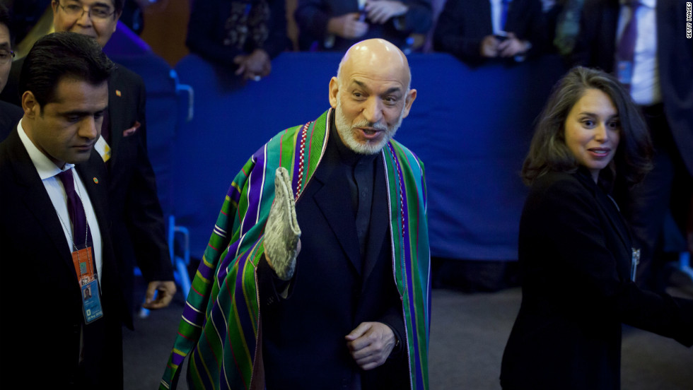Afghan President Hamid Karzai, center, arrives on Tuesday.