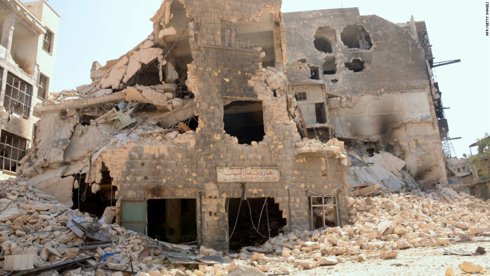 Rubble surrounds buildings destroyed by fighting between Syrian government troops and rebel forces in Aleppo on Monday.
