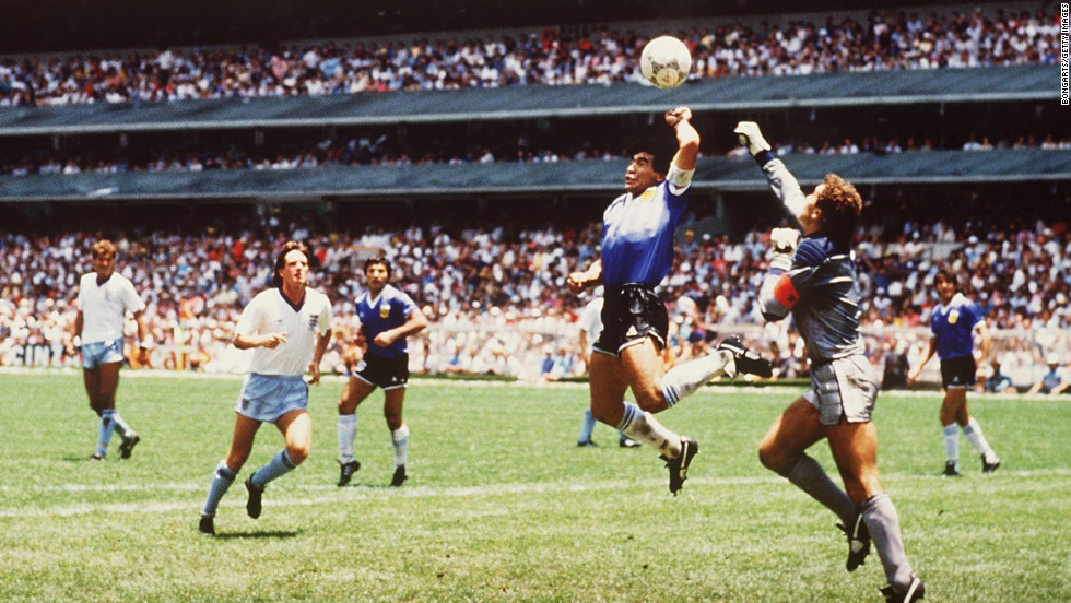 "Argentina's Diego Maradona illegally touched the ball with his hand while scoring a goal against England in soccer's 1986 World Cup tournament. It became known as the ""Hand of God"" after Maradona credited divine intervention for the dubious goal."