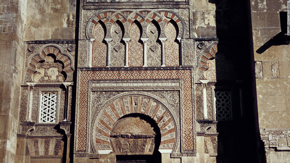 The Moorish arch at the entrance to the Mosque (or Mezquita) in Cordoba. It was consecrated as a Christian church in 1236, and in the 16th century, a cathedral nave was built in its center.