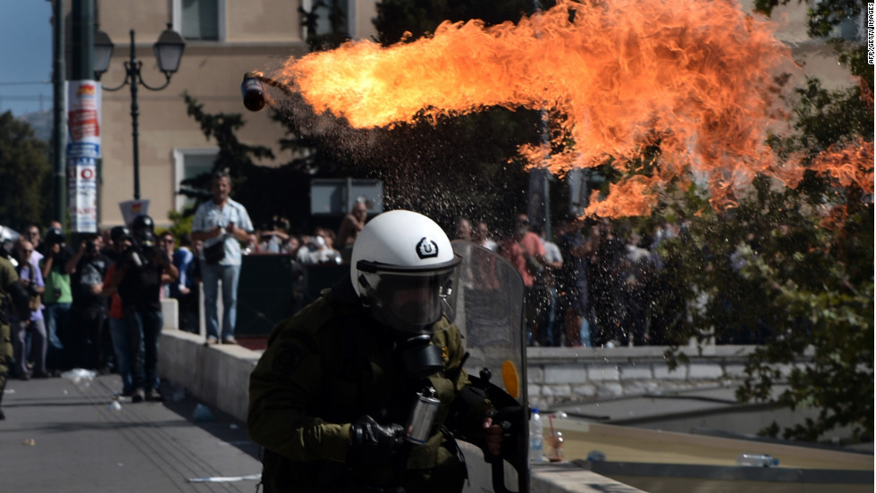 Firebombs explode in front of riot police Wednesday.