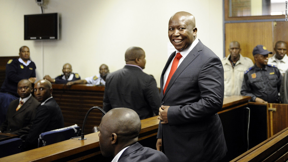 Malema smiles after arriving at the courthouse in Polokwane, north of Johannesburg. The 31-year-old has been charged with money laundering and is now released on bail with a fee set at 10,000 rand (945 euro, $1,215).