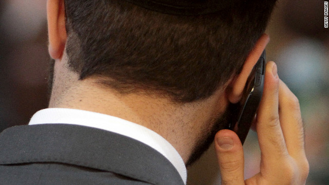 COLOGNE, GERMANY - SEPTEMBER 13:  A participant in a rabbi ordination ceremony talks on a mobile phone at the Synagogue Community Centre on September 13, 2012 in Cologne, Germany. Jewish leaders and German politicians attended the ceremony in which four rabbis were ordained in the first rabbi ordination in Cologne since the Holocaust. All four rabbis attended the Rabbinical Seminary in Berlin. Cologne has a Jewish community first referred to in Roman records in the year 321. The Nazis deported 11,000 Jews to concentration camps during the Holocaust.  (Photo by Juergen Schwarz/Getty Images)