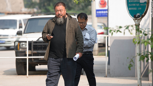 Chinese artist Ai Weiwei (C) leaves court on Thursday after his final appeal against tax evasion charges was rejected.