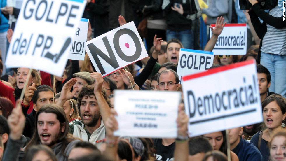 Protesters take part in a demonstration organized by Spain's 'indignant' protesters on September 26, 2012 in Madrid, a day after a mass protest in which police beat and fired rubber bullets at demonstrators.