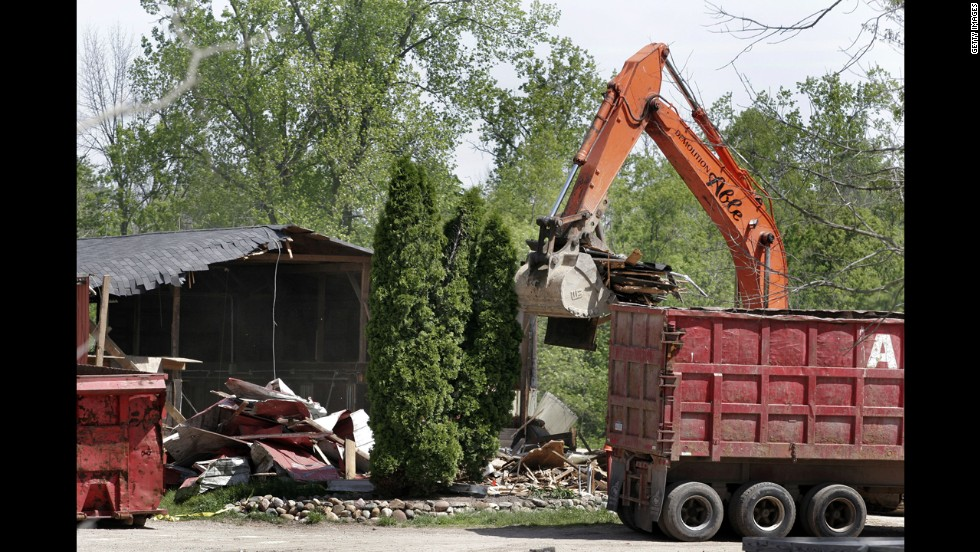 "Demolition workers tear down a horse barn for the FBI in 2006 in a search for Hoffa's remains in Milford, Michigan. <a href=""http://www.cnn.com/2006/US/05/17/hoffa.search/index.html"">The FBI had received a tip</a> that Hoffa was buried on the farm."