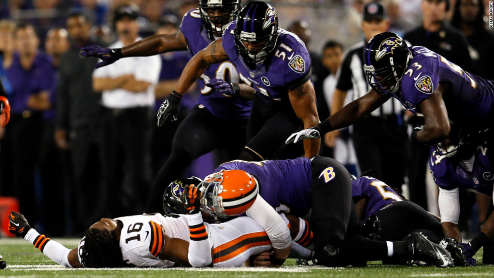 Wide receiver Joshus Cribbs of the Cleveland Browns lies unconscious on the ground after getting hit by linebacker Dannell Ellerbe in the first quarter Thursday.