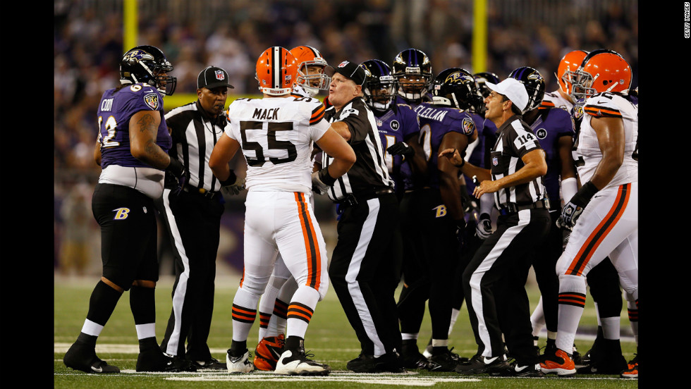Umpire Bill Schuster, center, and referee Gene Steratore break up a fight between Cleveland Browns and Baltimore Ravens players during the game on Thursday.