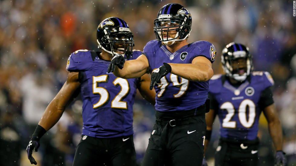 Outside linebacker Paul Kruger, center, of the Baltimore Ravens celebates after inside linebacker Ray Lewis, left, sacked Browns quarterback Brandon Weeden on Thursday.