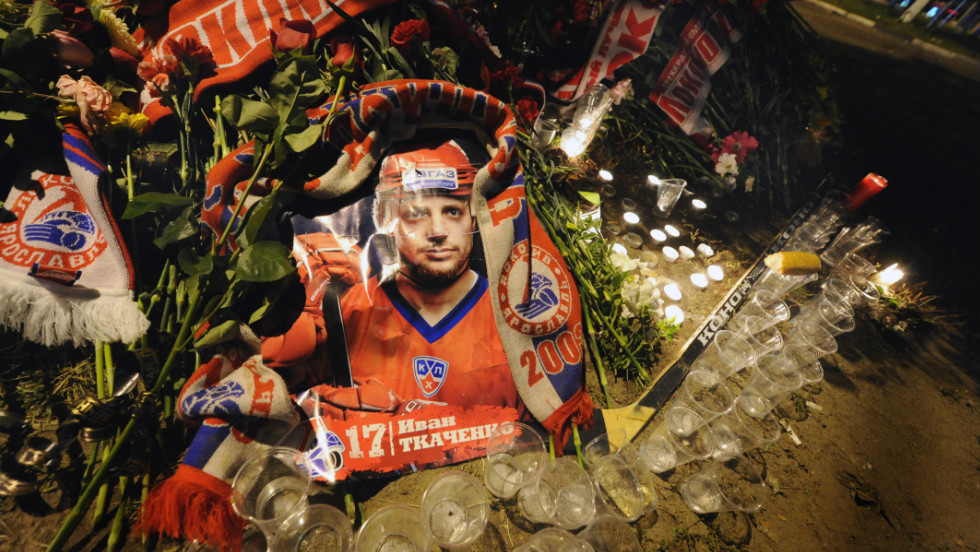 A picture of Ivan Tkachenko was surrounded by candles and glasses in front of the Lokomotiv Stadium as fans flocked to the Arena-2000 to pay their respects.