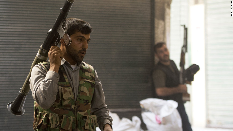 "Syrian rebels take their position during fighting with government troops in Aleppo on Friday, September 28. Syrian forces clashed with opposition fighters in the nation's largest city after the launch of a ""decisive battle"" to push regime soldiers out, opposition activists said."