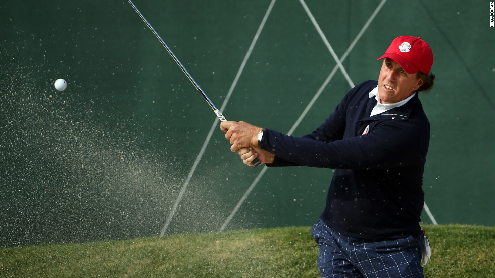 Phil Mickelson plays a bunker shot on 10th tenth hole on Friday.