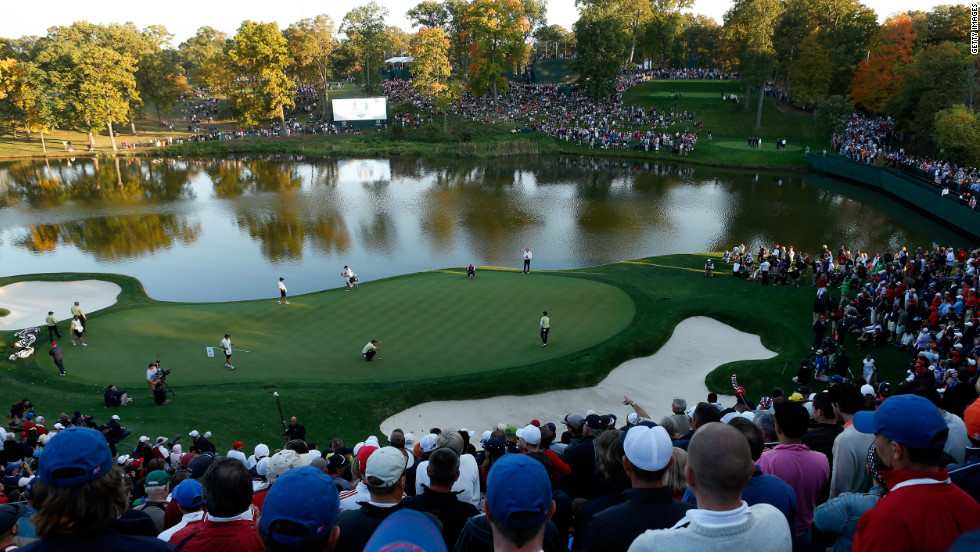 Fans watch the play on the 17th hole on Friday.