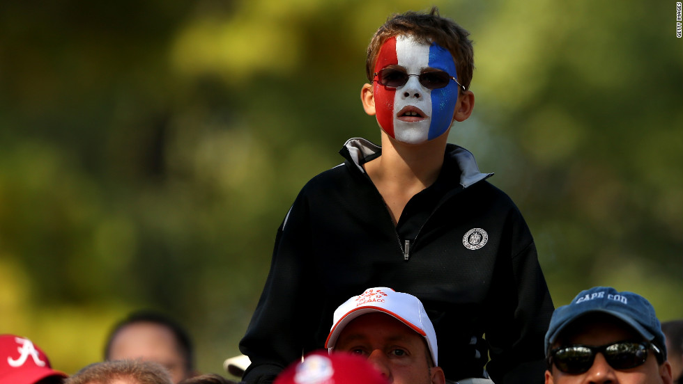 A fan of the U.S. golfers watches the action.
