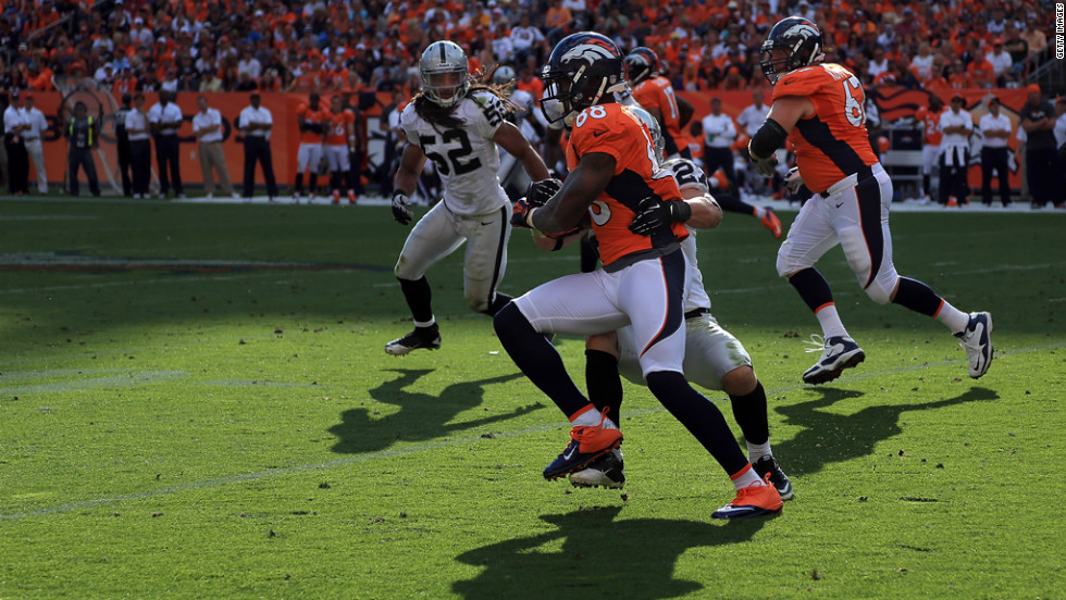 Demaryius Thomas of the Denver Broncos runs the ball Sunday against the Oakland Raiders.
