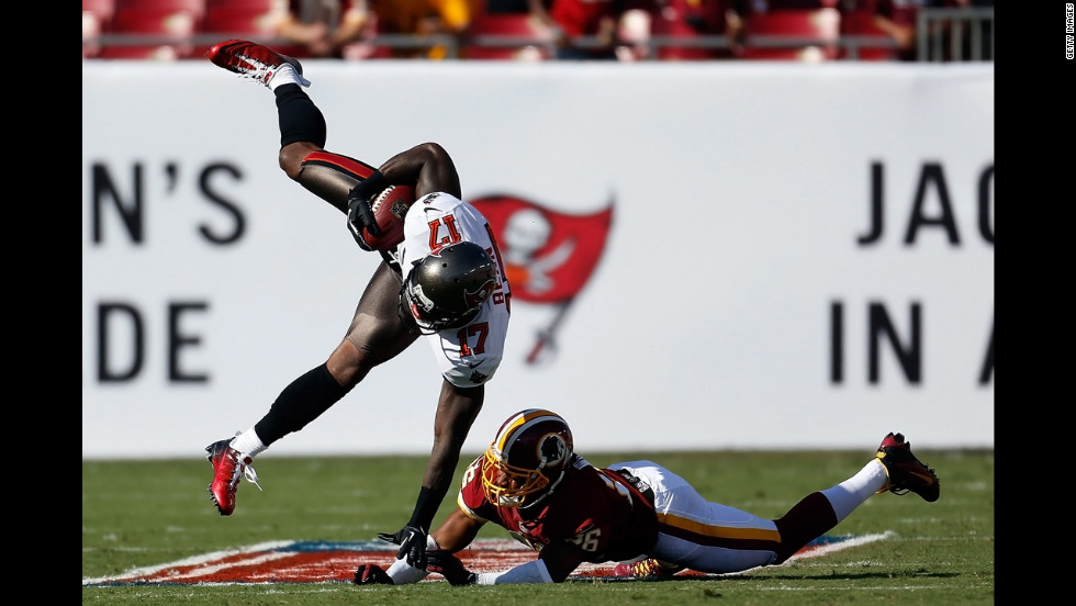 Josh Wilson of the Washington Redskins hits receiver Arrelious Benn of the Tampa Bay Buccaneers on Sunday.