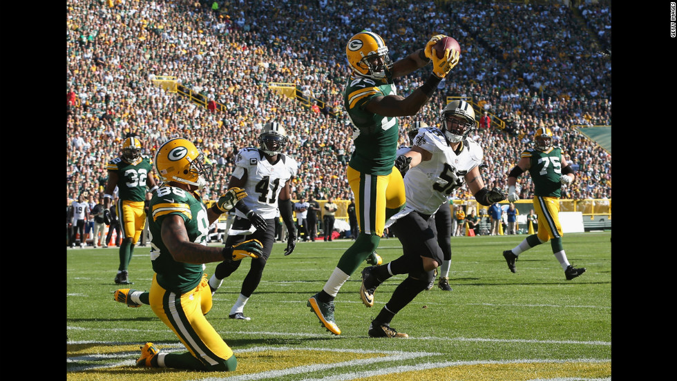 James Jones of the Green Bay Packers catches a pass for a touchdown Sunday against the New Orleans Saints at Lambeau Field in Green Bay, Wisconsin.