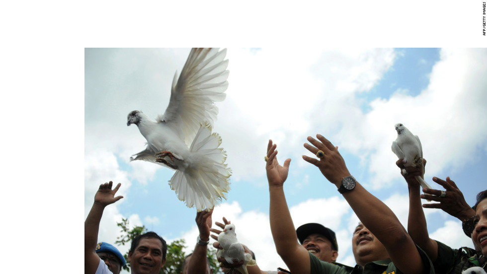 Indonesians release white pigeons in front of the Nyoman Cafe in Jimbaran on Bali on Monday, the seventh anniversary of terrorist bomb blasts that killed at least 24 people.