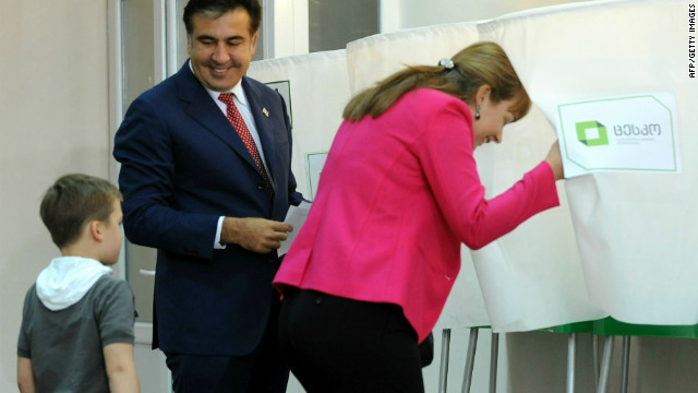 President Mikheil Saakashvili and his wife Sandra Roelofs cast their votes at a polling station in Tbilisi on October 1, 2012.