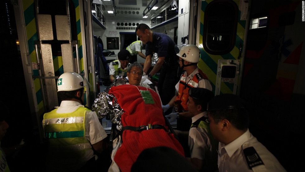 "A survivor is helped onto an ambulance. The crash necessitated what local police called a ""major rescue"" operation, according to China's state-run media."