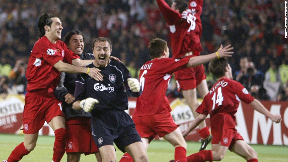 Liverpool players celebrate with goalkeeper Jerzy Dudek (in black) after the English side completed their remarkable comeback against Italians AC Milan in the 2005 European Champions League final. Trailing 3-0 at half time, Liverpool scored three goals in six second half minutes in Istanbul to force extra time and a penalty shoot-out, which they won 3-2.