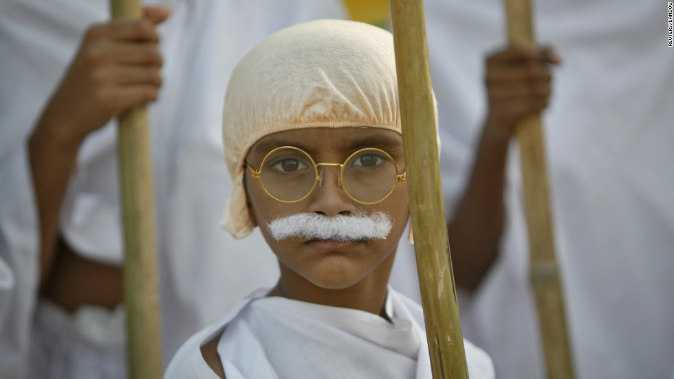 A schoolboy dressed as Gandhi takes part in a march on Tuesday.
