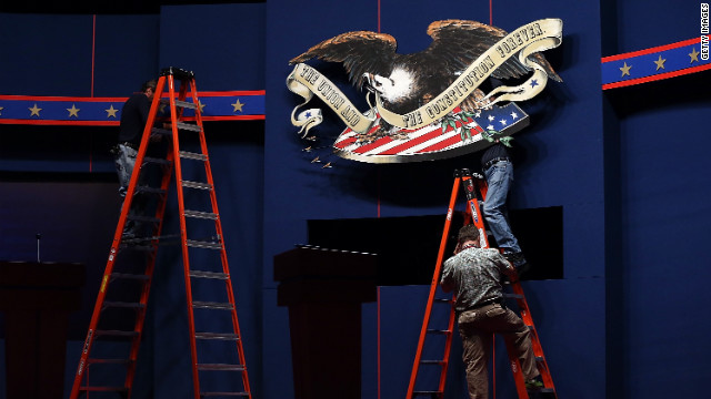 Workers prepare the stage ahead of the first 2012 presidential debate at the University of Denver on Tuesday.